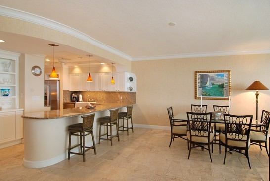Real Estate Photography - 2001 SE Sailfish Blvd, Unit 116, Stuart, FL, 34496 - Kitchen / Dining Room