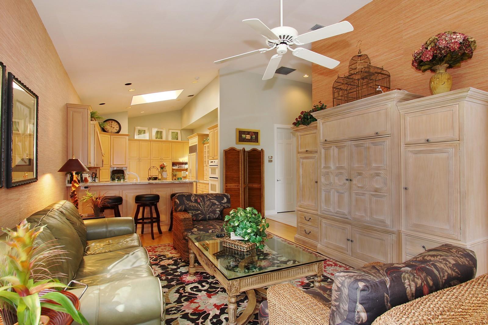 Real Estate Photography - 6930 SE Lakeview Ter, Stuart, FL, 34996 - Family Room / Kitchen